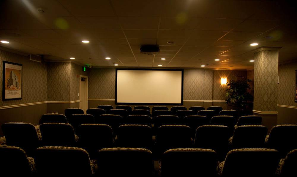 Empty seats in front of a large screen in the Cohawney Cinema at The Ambassador