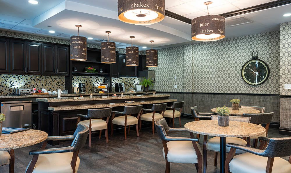 A view of the tables, chairs and main counter setup in the Five Corners Bistro at The Ambassador