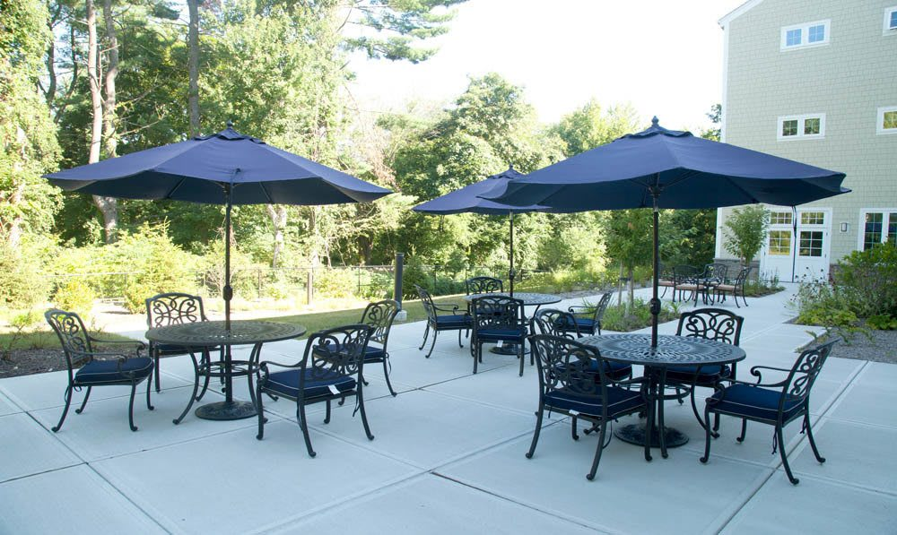 Tables, chairs and umberalls set on the patio outside the Five Corners Bistro at The Ambassador