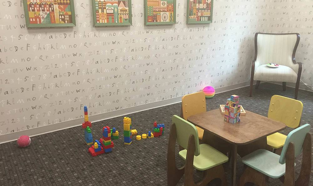 Kids tables and chairs and lego blocks set up in the Rumpus Room at The Ambassador