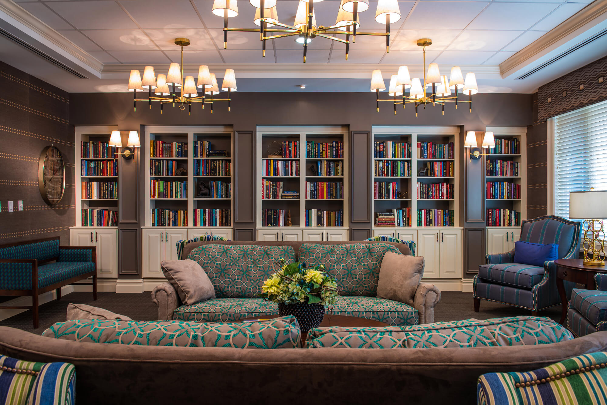 View of the couch and bookshelves in the Popham Library at The Ambassador